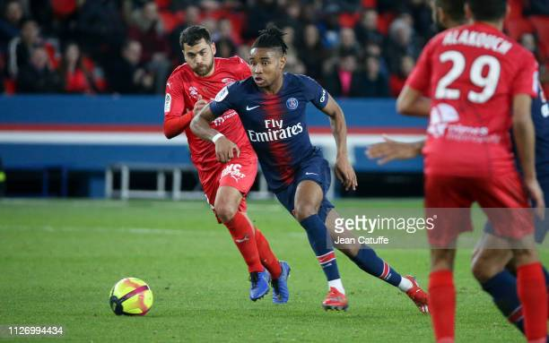 Christopher Nkunku of PSG, Teji Savanier of Nimes during the French Ligue 1 match between Paris Saint-Germain and Nimes Olympique at Parc des Princes...