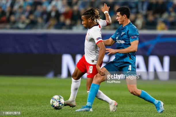 Christopher Nkunku of RB Leipzig and Yordan Osorio of FC Zenit Saint Petersburg vie for the ball during the UEFA Champions League Group G match...