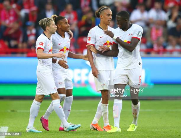 Christopher Nkunku of RB Leipzig celebrates after scoring his team's fourth goal with Kevin Kampl Yussuf Poulsen and Ibrahima Konate during the...