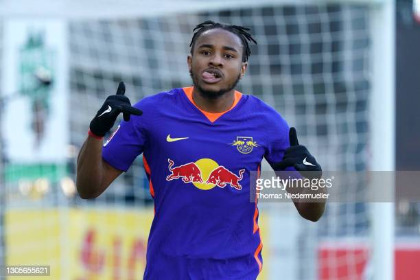 Christopher Nkunku of RB Leipzig celebrates after scoring their side's first goal during the Bundesliga match between Sport-Club Freiburg and RB...