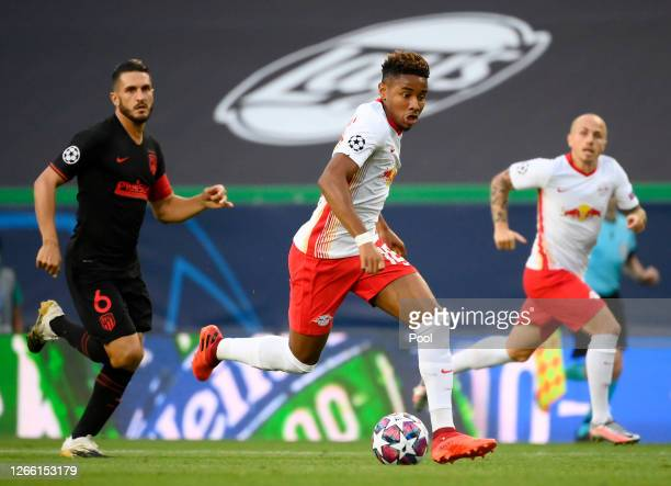 Christopher Nkunku of RB Leipzig controls the ball during the UEFA Champions League Quarter Final match between RB Leipzig and Club Atletico de...