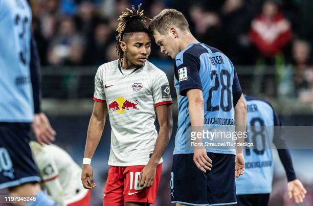 Christopher Nkunku of RB Leipzig struggles with Matthias Ginter of Borussia Mönchengladbach during the Bundesliga match between RB Leipzig and...