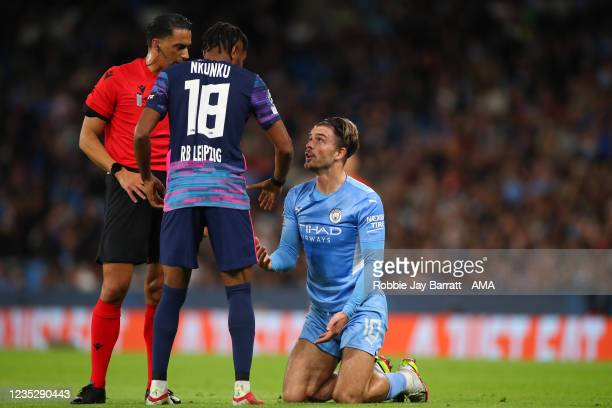 Christopher Nkunku of RB Leipzig talks to Jack Grealish of Manchester City during the UEFA Champions League group A match between Manchester City and...