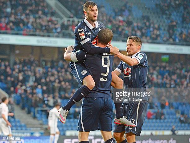 Christopher Noethe Fabian Klos and Sebastian Schuppan of Bielefeld celebrate during the Second Bundesliga match between Arminia Bielefeld and SC...