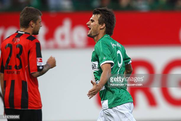Christopher Noethe of Fuerth celebrates scoring the first team goal whilst Marco Russ of Frankfurt looks on during the Second Bundesliga match...