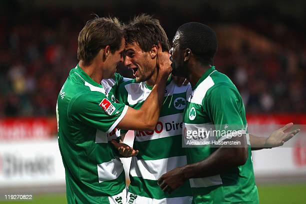 Christopher Noethe of Fuerth celebrates scoring the second team goal with his team mate Thomas Kleine and Olivier Occean during the Second Bundesliga...