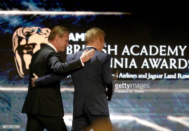 Christopher Nolan presents Kenneth Branagh with Albert R Broccoli Britannia Award for Worldwide Contribution to Entertainment onstage at the 2017 AMD...