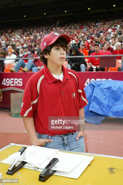 Christopher Nolan son of Head Coach Mike Nolan of the San Franciscs 49ers looks on during the game against the Arizona Cardinals at Monster Park on...
