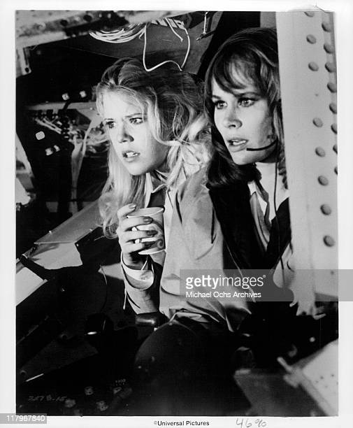Christopher Norris holding a cup and Karen Black with microphone in a scene from the film 'Airport' 1970