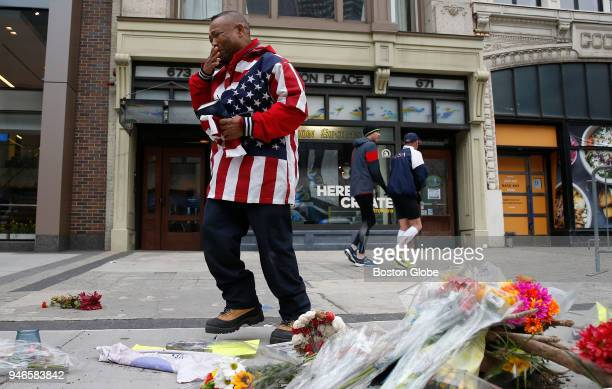 Christopher Nzenwa of Boston is overcome with emotion after praying in front of a memorial at the site where one of the bombs went off on April 15...