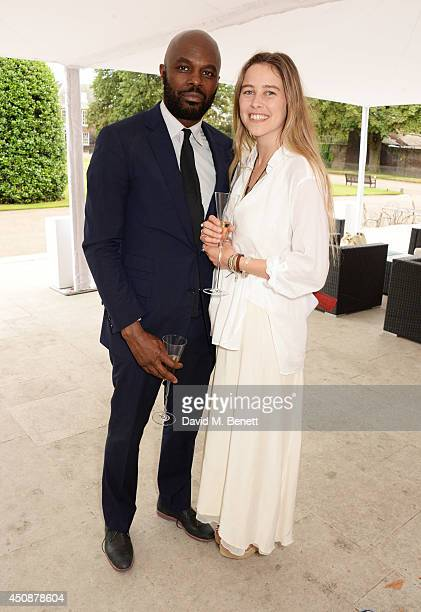 Christopher Obi and Maddison Brudenell attend the drinks reception hosted by Dockers, the San Francisco based apparel brand, at Kensington Palace on...