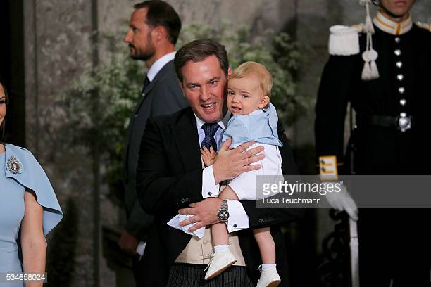 Christopher O'Neill and Prince Nicolas of Sweden are seen at The Royal Palace for the Christening of Prince Oscar of Sweden on May 27 2016 in...