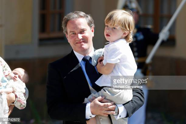 Christopher O'neill holding Prince Nicolas of Sweden pose after the christening of Princess Adrienne of Sweden at Drottningholm Palace Chapel on June...