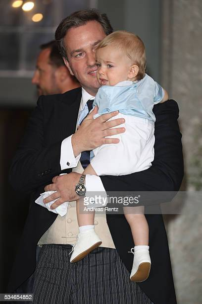 Christopher O'Neill holds his son Prince Nicolas of Sweden are seen after the christening of Prince Oscar of Sweden at Royal Palace of Stockholm on...