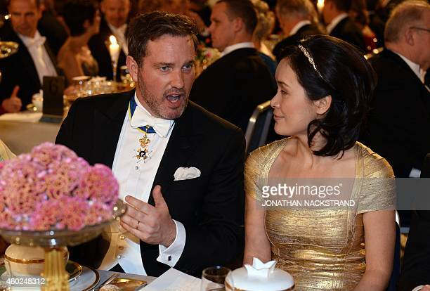 Christopher ONeill, husband of Princess Madeleine of Sweden talks with Na Ji, spouse of the 2014 Nobel chemistry laureate Eric Betzig during the...