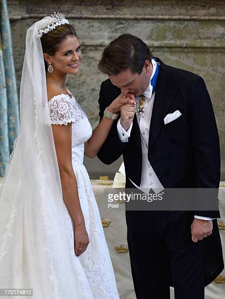 Christopher O'Neill kisses the hand of his bride Princess Madeleine of Sweden during the wedding ceremony of Princess Madeleine of Sweden and...