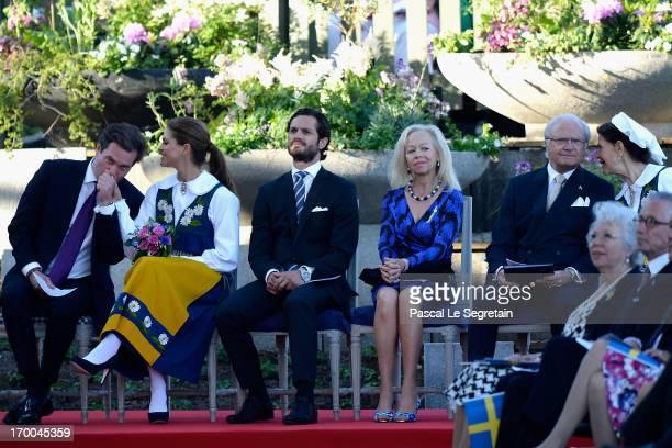 Christopher O'Neill kisses the hand of Princess Madeleine of Sweden as Prince Carl Philip of Sweden, Ylwa Soederberg, King Carl XVI Gustaf of Sweden...