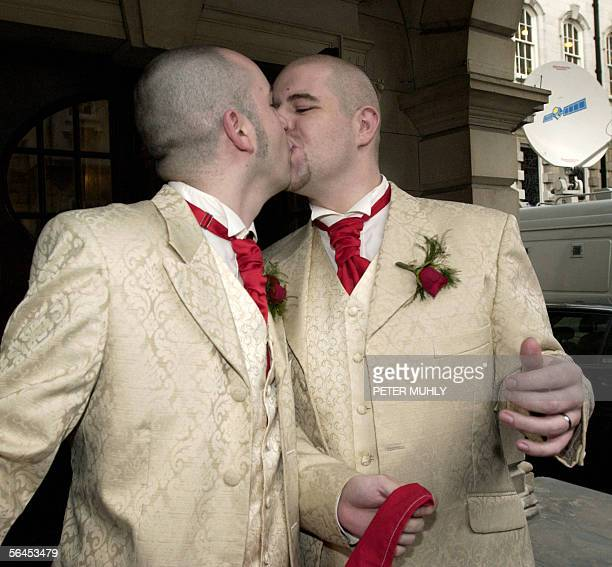 Christopher Patrick Flangan and his partner Henry Emmauel Kane kiss as they come out of Belfast City Hall in Northern Ireland 19 December 2005 after...