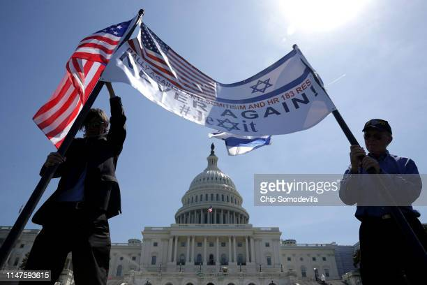 Christopher Paulsen of Sarasota Florida and Stan Moore of Nashville Tennessee raise a banner before a rally against antisemitism and in support of...