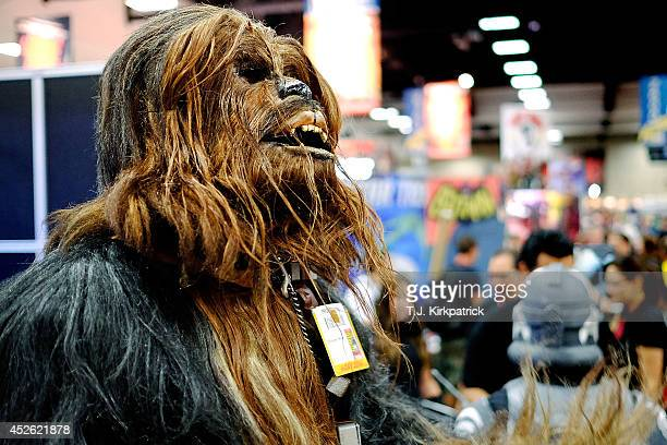 Christopher Petrone of San Diego CA towering over attendees in his handmade toscale Chewbacca costume gives a roar to fans during the 45th annual San...