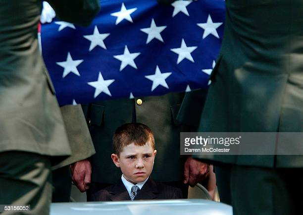 Christopher Piper , son of Army Staff Sgt. Christopher Piper, sits graveside June 27, 2005 during a funeral for the fallen soldier in Marblehead,...