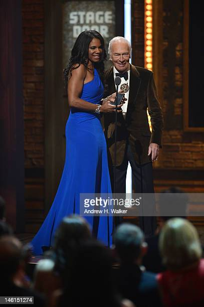 Christopher Plummer presents Audra McDonald with the award for Best Performance by a Leading Actress in a Musical for Porgy and Bess onstage at the...