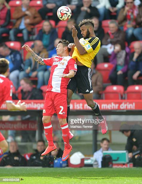Christopher Quiring of 1FC Union Berlin and Phil OfosuAyeh of VfR Aalen during the game between Union Berlin and VfR Aalen on april 12 2015 in Berlin...