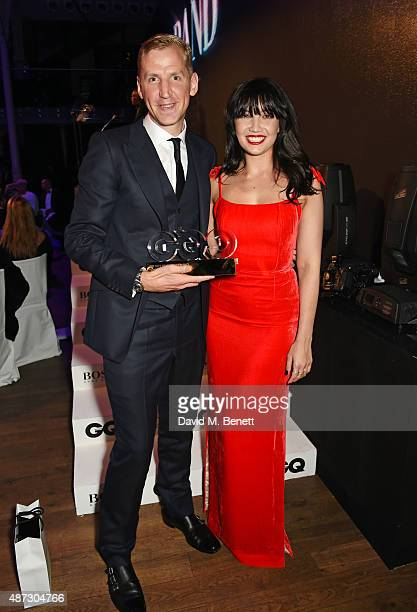 Christopher Raeburn winner of Breakthrough Designer of the Year and Daisy Lowe attend the GQ Men Of The Year Awards at The Royal Opera House on...
