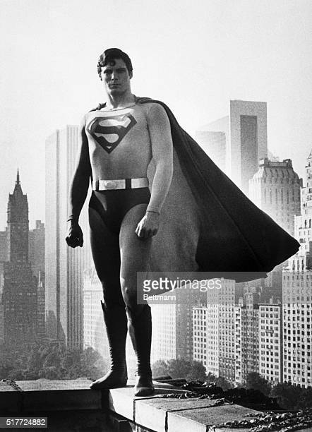 Christopher Reeve wears the cape of Superman in the 1978 film of the same name Reeve stands on the roof of a midtown Manhattan building
