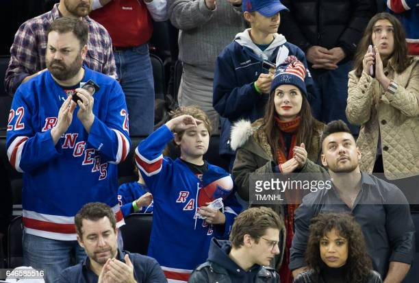 Christopher Roach Debra Messing and Roman Walker Zelman are seen at Madison Square Garden on February 28 2017 in New York City