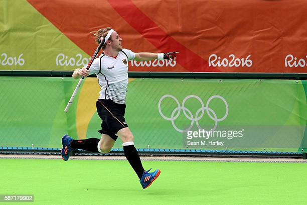 Christopher Ruhr of Germany celebrates a goal against India during a Men's Pool B match on Day 3 of the Rio 2016 Olympic Games at the Olympic Hockey...
