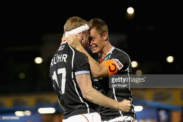 Christopher Ruhr of Germany celebrates scoring the winning the penalty with Mats Grambusch of Germany during the semifinal match between Spain and...