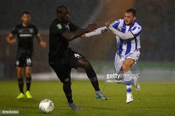 Christopher Samba of Aston Villa challenges Drey Wright of Colchester during the Carabao Cup First Round match between Colchester United and Aston...