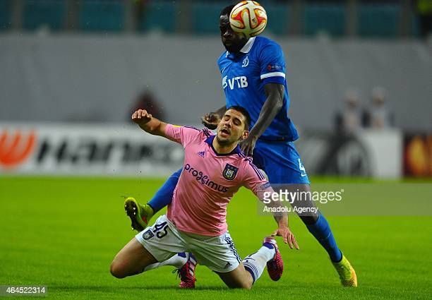 Christopher Samba of Dynamo Moscow view with Alexander Mitrovic of Anderlecht during the UEFA Europe League football match between Dynamo Moscow and...