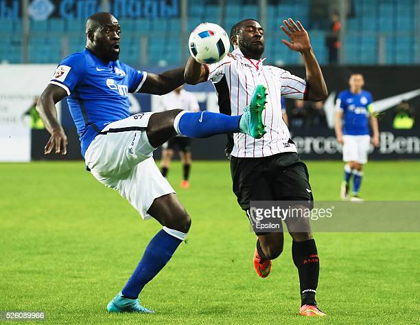 Christopher Samba of FC Dinamo Moscow and Bright Dike of FC Amkar Perm vie for the ball during the Russian Football League match between FC Dinamo...