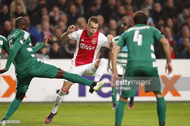 Christopher Samba of Panathinaikos FC Vaclav Cerny of Ajax Giorgos Koutroumpis of Panathinaikos FCduring the UEFA Europa League group G match between...