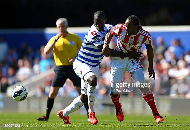 Christopher Samba of QPR and Cameron Jerome of Stoke compete for the ball during the Barclays Premier League match between Queens Park Rangers and...