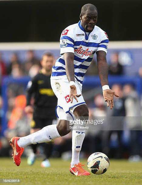 Christopher Samba of Queens Park Rangers with the ball during the Barclays Premier League match between Queens Park Rangers and Wigan Athletic at...