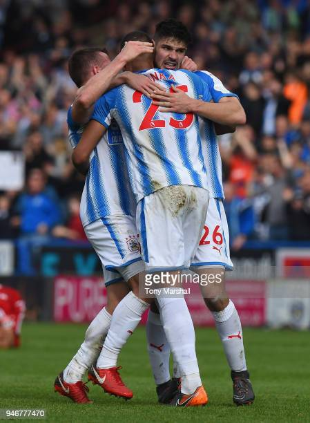 Christopher Schindler Mathias Zanka and Jonathan Hogg of Huddersfield Town celebrate their win at the final whistle during the Premier League match...