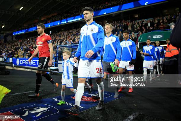 Christopher Schindler of Huddersfield leads his team out onto the pitch for The Emirates FA Cup Fifth Round match between Huddersfield Town and...