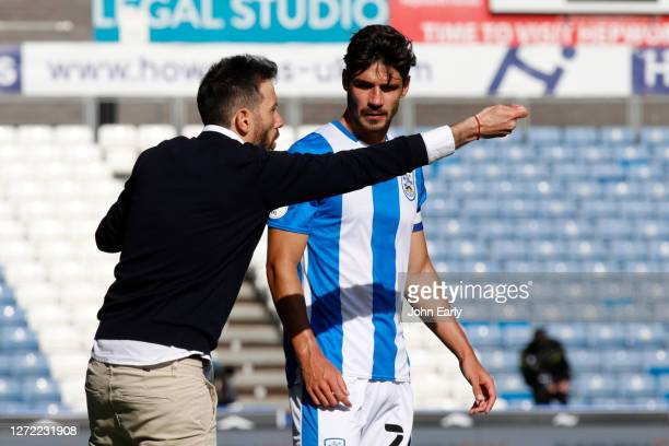 Christopher Schindler of Huddersfield Town and Carlos Coberán the Head Coach of Huddersfield Town during the Sky Bet Championship match between...