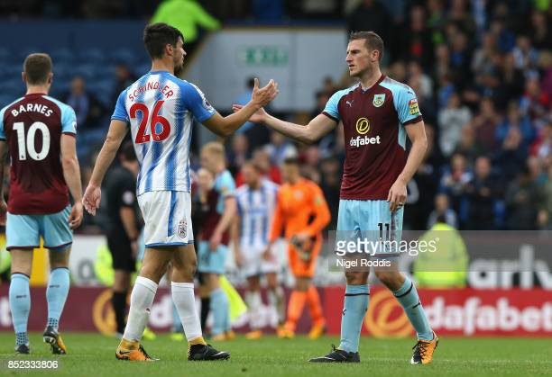 Christopher Schindler of Huddersfield Town and Chris Wood of Burnley shake hands after the Premier League match between Burnley and Huddersfield Town...