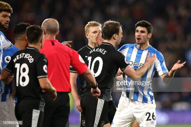 Christopher Schindler of Huddersfield Town argues with the referee after being shown a red card during the Premier League match between Huddersfield...