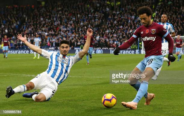 Christopher Schindler of Huddersfield Town attempts to block a cross from Felipe Anderson of West Ham United during the Premier League match between...