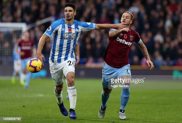 Christopher Schindler of Huddersfield Town battles for possession with Marko Arnautovic of West Ham United during the Premier League match between...