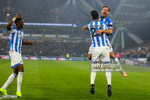Christopher Schindler of Huddersfield Town celebrates after scoring a goal to make it 10 during the Premier League match between Huddersfield Town...