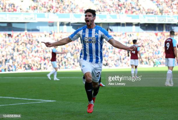 Christopher Schindler of Huddersfield Town celebrates after scoring his team's first goal during the Premier League match between Burnley FC and...