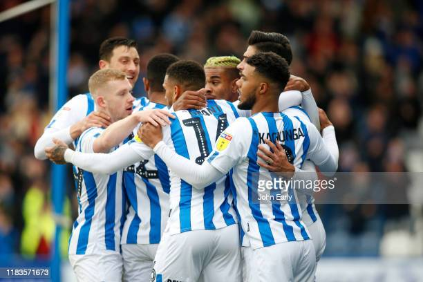 Christopher Schindler of Huddersfield Town celebrates his opening goal with Juninho Bacuna Tommy Elphick Lewis O'Brien and Karlan Grant during the...