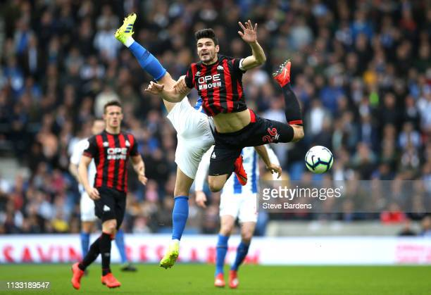 Christopher Schindler of Huddersfield Town collides with Alireza Jahanbakhsh of Brighton and Hove Albion during the Premier League match between...
