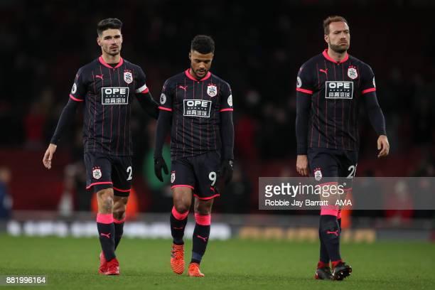 Christopher Schindler of Huddersfield Town Elias Kachunga of Huddersfield Town and Laurent Depoitre of Huddersfield Town dejected at full time during...